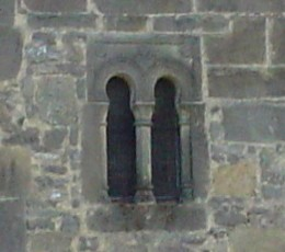 San Salvador de Valdediós: Window with alfiz and horseshoe arches, of clear Mozarabic influence